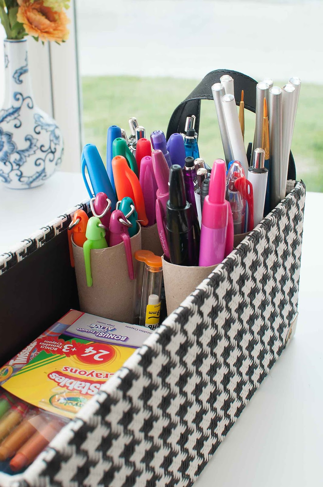 Use a gift wrap cardboard tube to organize markers and pens for a home office, craft room or playroom.
