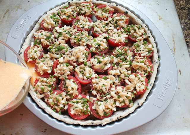 Food Lust People Love: In this Stuffed Plum Tomato Tart with Black Olive Shortcrust, the flavors are Mediterranean, from the red ripe plum tomatoes and the mozzarella and anchovy stuffing, to the black olive shortcrust.