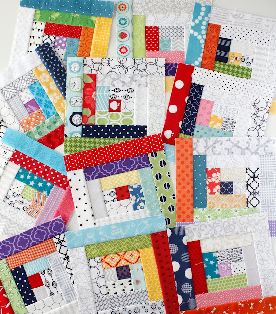 Fun and scrappy log cabin blocks by A Bright Corner.  She had a free downloadable paper piecing pattern!