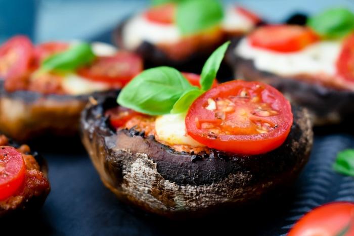 A close up of BBQ Pizza Stuffed Mushrooms