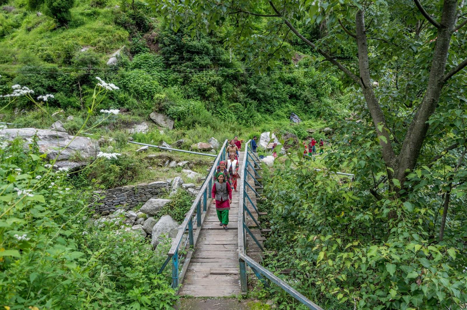 Womenfolk crossing the bridge near Singhaad en route Srikhand Mahadev Yatra