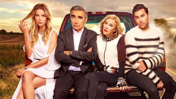 image of the Rose family, from Schitt's Creek: Annie Murphy as Alexis; Eugene Levy as Johnny; Catherine O'Hara as Moira; and Dan Levy as David