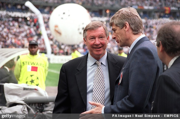 Sir Alex Ferguson and Arsène Wenger chat prior to match