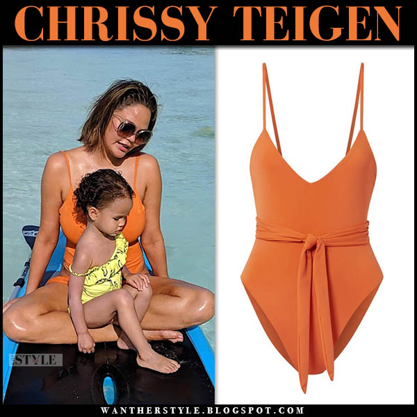Chrissy Teigen in orange mara hoffman swimsuit and chloe sunglasses vacation beach style january 4