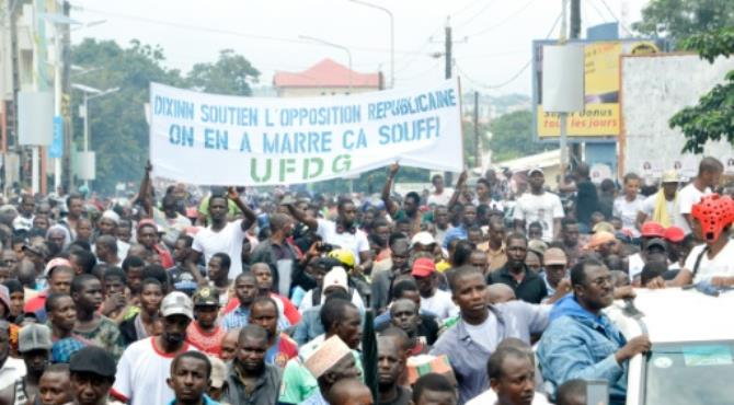 """At least half a million Guineans joined a massive opposition rally in Conkary on Tuesday to denounce alleged economic mismanagement and corruption by the government of President Alpha Conde.Guinean opposition supporters march with a banner reading """"Support the opposition. We've had enough"""" during an anti-government protest in Conakry on August 16, 2016. By Cellou Binani (AFP)"""
