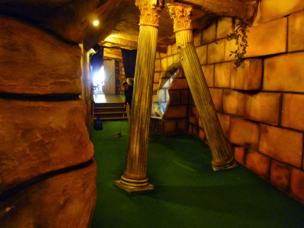 Hole 1 at the indoor Adventure Golf course in Felixstowe has two cups to choose to putt into on the revolving green once you get passed the columns!