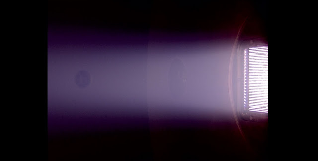 Image of the Neptune thruster (right) with plasma expanding into a space simulation chamber  CREDIT: Dmytro Rafalskyi