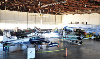 WWII planes inside an airplane hangar