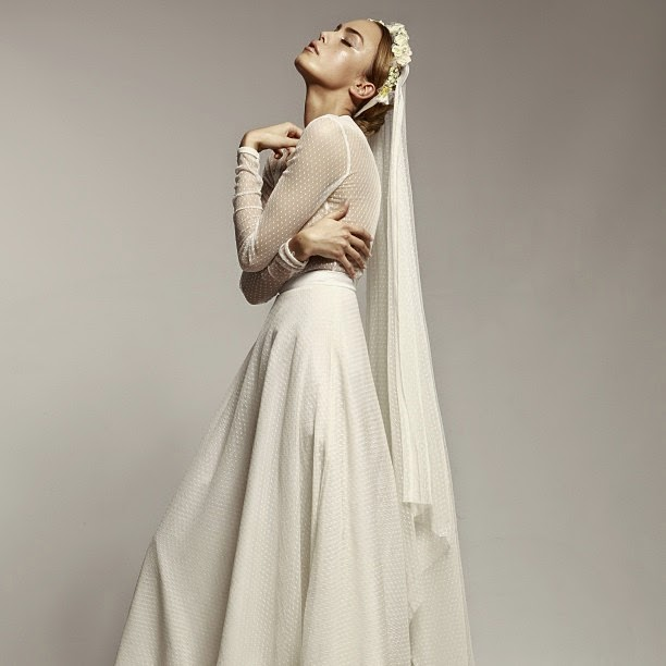Wearing a Traditional Long Sleeve Wedding Dress with Long Veil