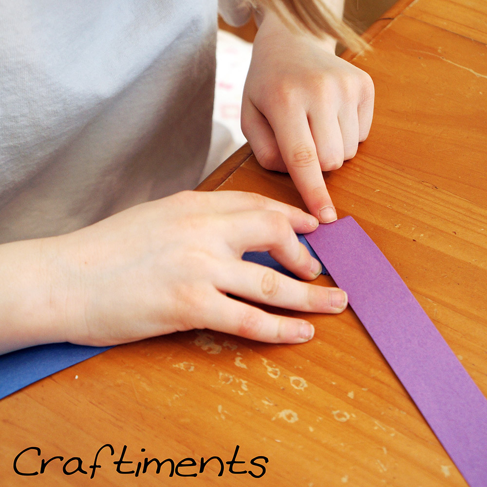 Making folded paper garland.