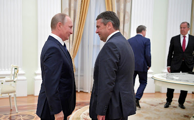 Vladimir Putin with German Vice Chancellor and Foreign Minister Sigmar Gabriel.
