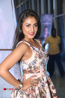 Actress Madhu Shalini Stills in Floral Short Dress at RGV Shiva to Vangaveeti Event  0048.JPG