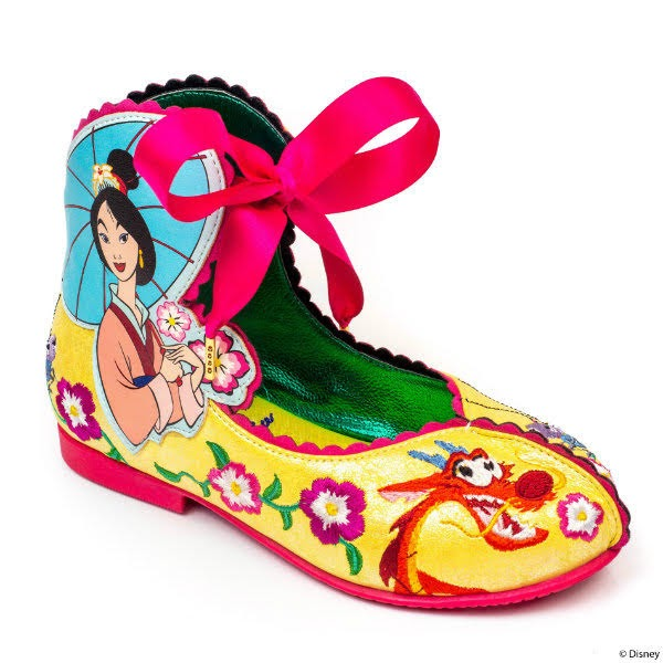 yellow kids shoe with embroidery and pink ribbon fastening