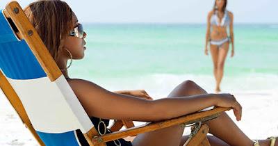 African American sun tanning