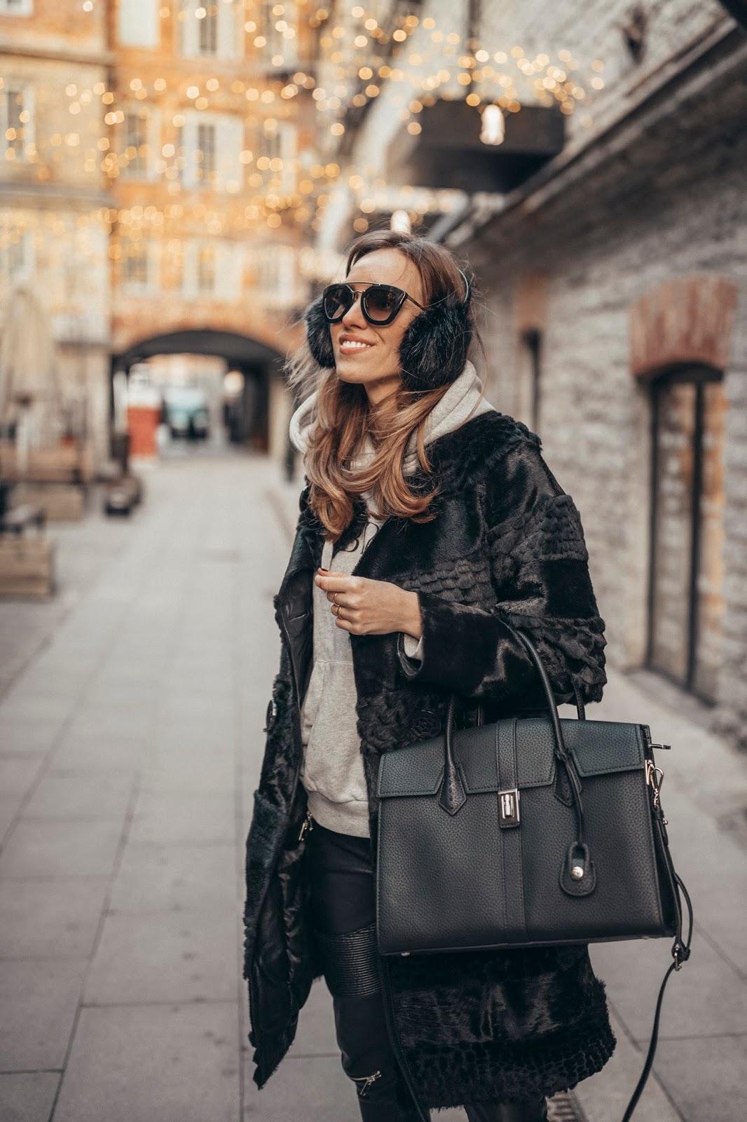 black fur coat ear muffs hoodie street style