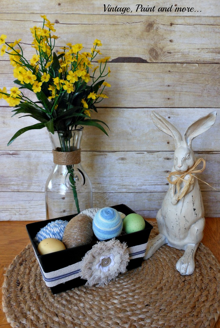 Vintage, Paint and more... Plain tin DIY'd with chalkboard paint and drop cloth fabric, yarn wrapped  Easter eggs, vintage milk bottle, vintage wood rabbit, and sisal placemat