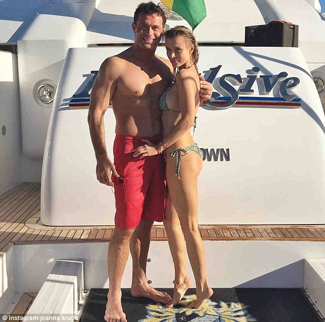 Joanna Krupa flaunts her peachy posterior in stringy geometric print bikini as she poses up a storm with husband Romain Zago on board a yacht in Miami