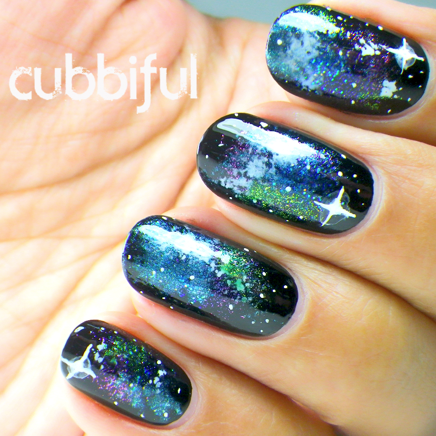starry galaxy nails