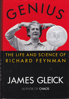 Cover of book showing Richard P. Feynman lecturing with his hands raised and index fingers pointing to each other.