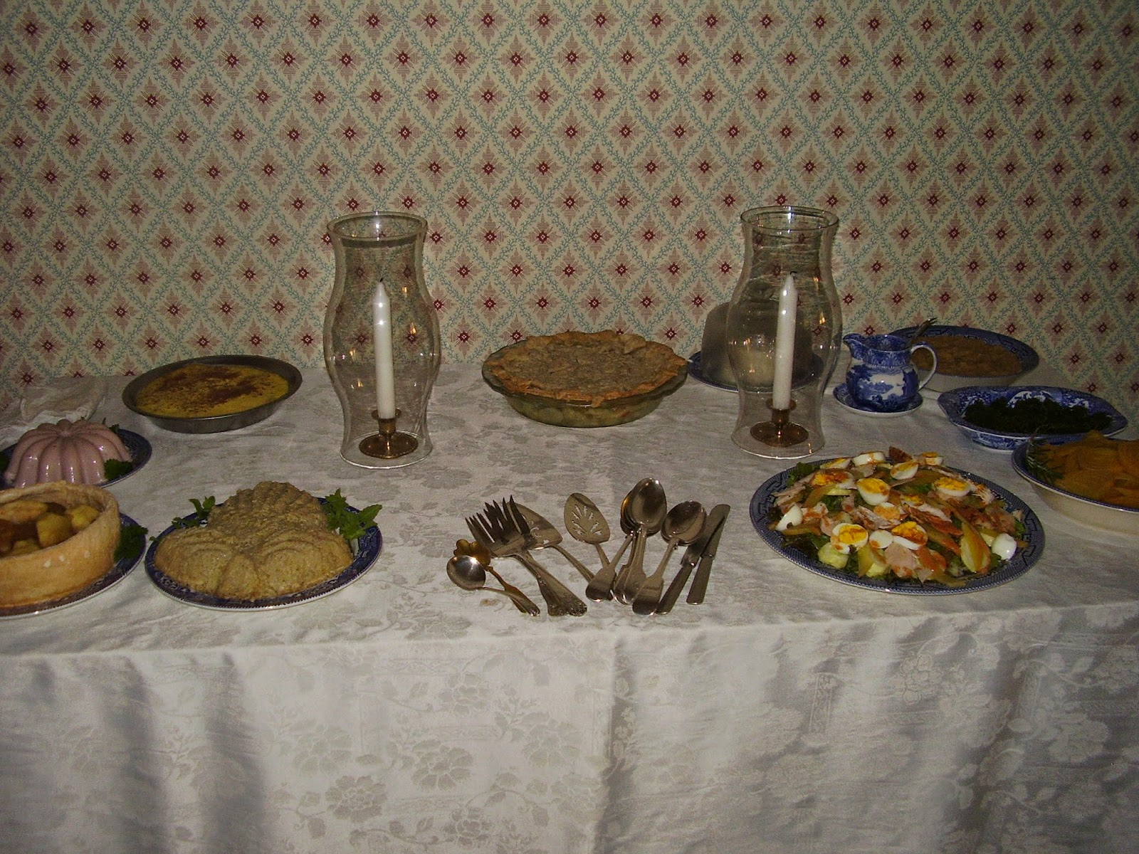 Side board with vegetable pie, chicken salad, boiled beets.