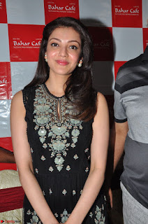 Kajal Aggarwal in lovely Black Sleeveless Anarlaki Dress in Hyderabad at Launch of Bahar Cafe at Madinaguda 037.JPG