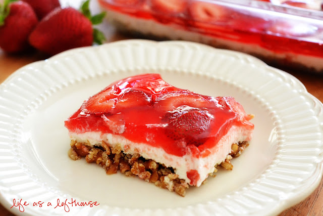 This delicious Strawberry Pretzel Salad is a dessert salad with a pretzel crust, a cream cheese filling topped with fresh strawberries and jello. Life-in-the-Lofthouse.com