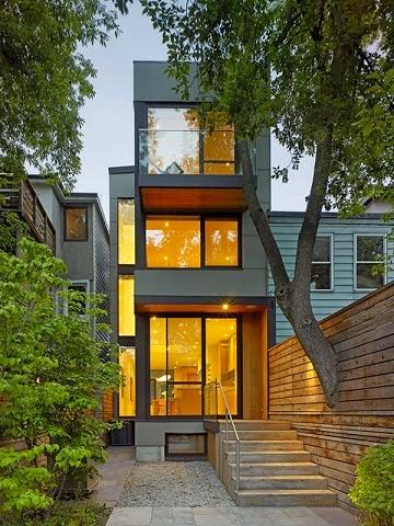 estas modernas fachadas de casas pequeas crean un acceso a la vivienda muy acogedor y bien iluminado relacionado con el entorno donde fueron proyectadas