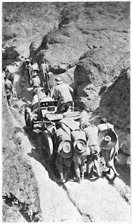 Volunteers haul the Itala through a  steep mountain pass