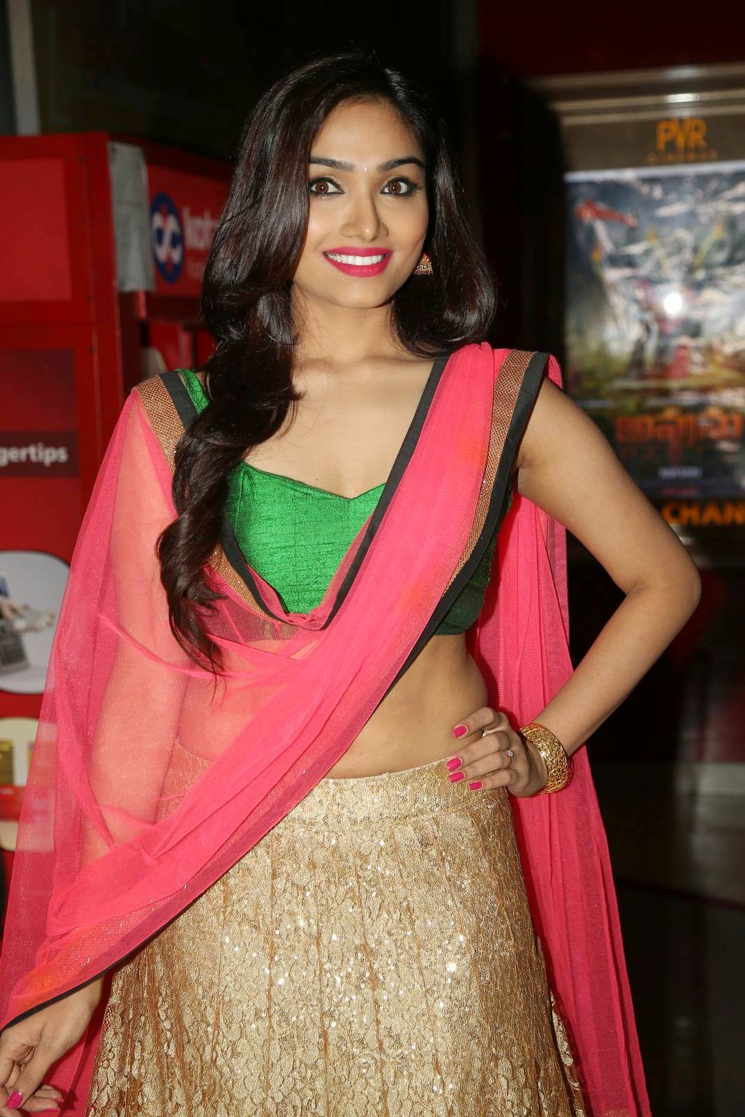 Actress Aishwarya Devan Latest Cute Hot Navel Show Spicy Photos Gallery At Anekudu Movie Audio Launch
