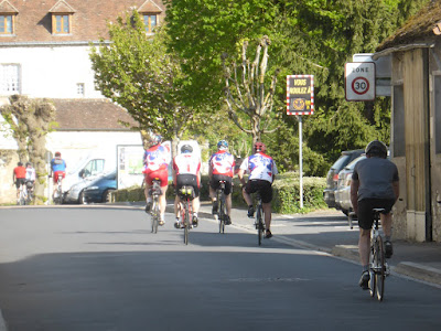 cyclists coming through Barrou in Southern Touraine