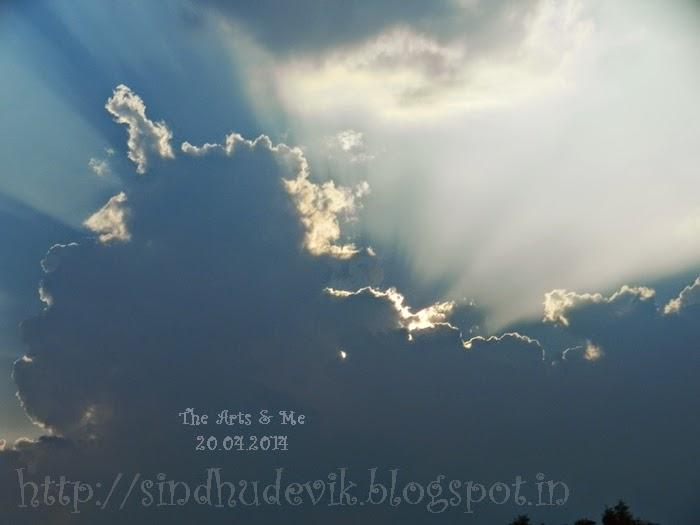 Sun hides behind the clouds near Belagavi (Belgaum, Karnataka, India)