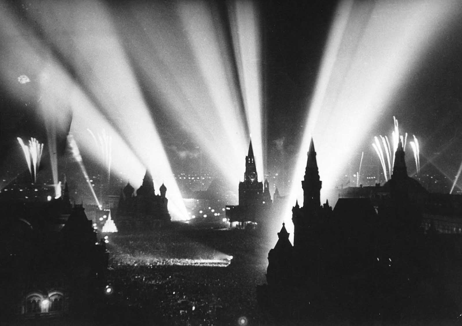 Celebration of Victory in Moscow's Red Square, in the Soviet Union. Fireworks began on May 9, 1945, followed by bursts of gunfire and a sky illuminated by searchlights.