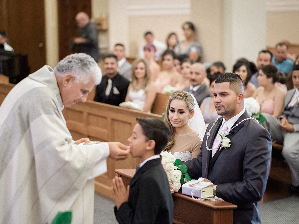 Catholic wedding ceremony, father blessing in St. Vincent de Paul Church