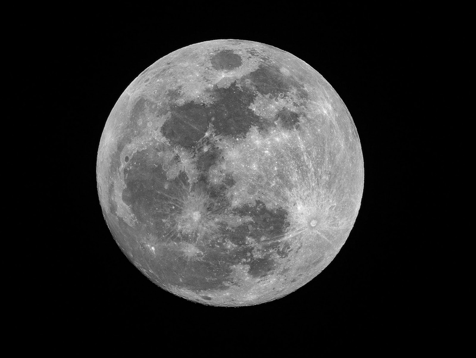 Close up photo of the moon, but with a pitch black background