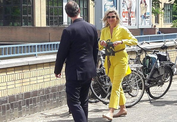 Queen Maxima wore Max Mara yellow blouse and trousers, Giuseppe Zanotti flat ballerinas. Sophie Habsburg Moneypenny watersnake clutch