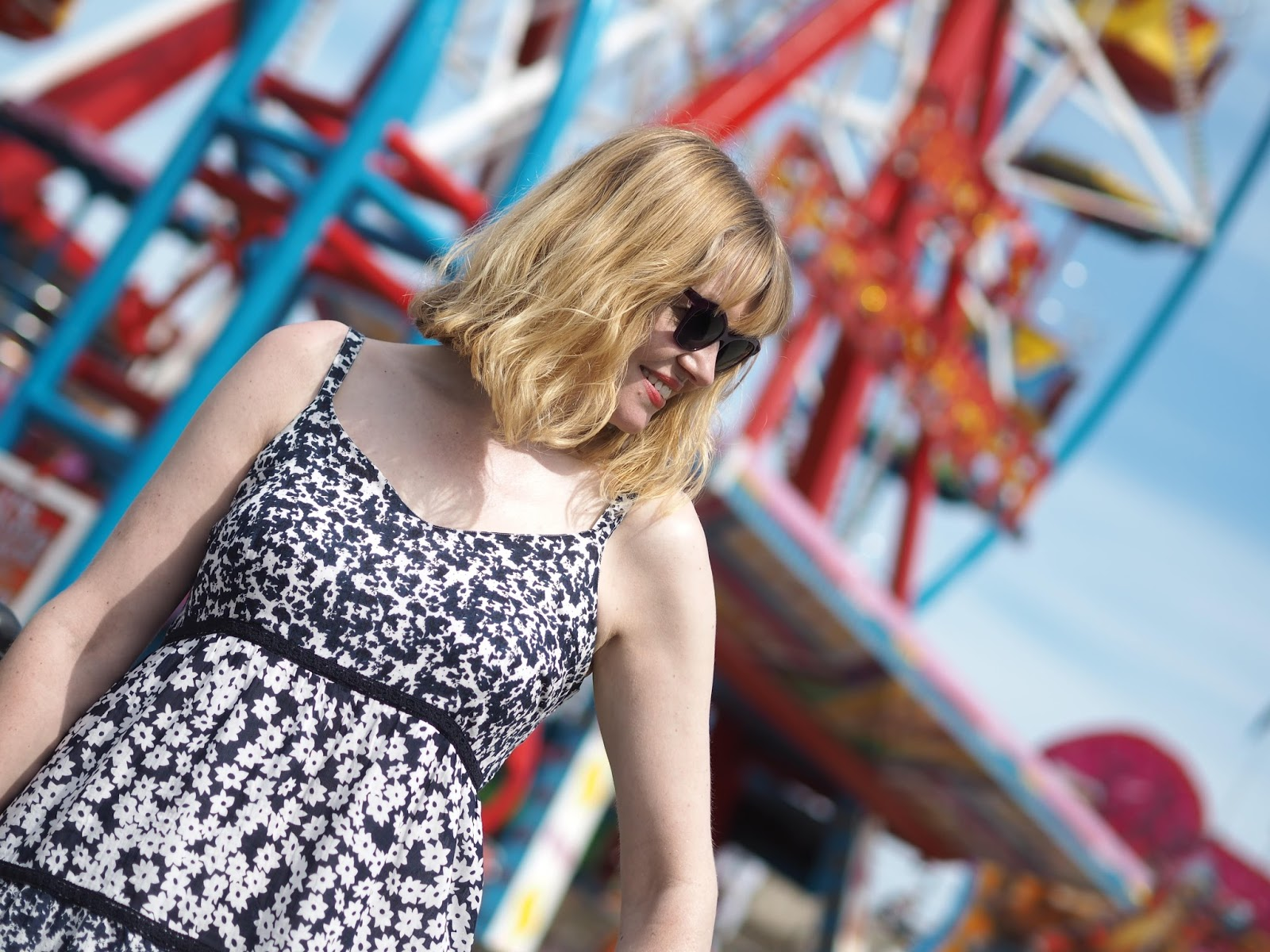 Blue floral sundress big wheel, fairground Scarborough