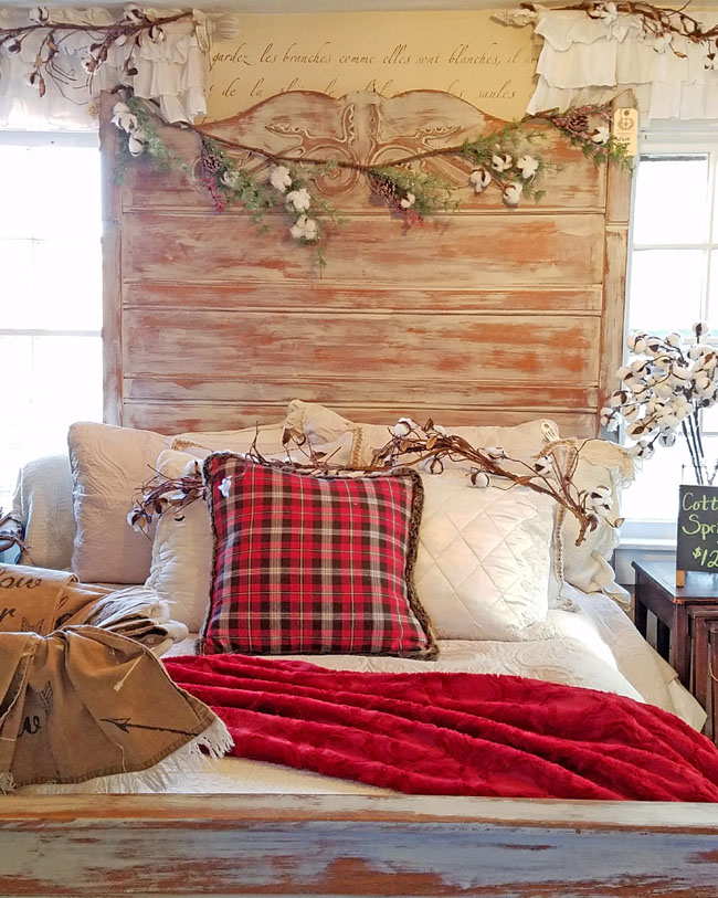 cotton branches garland on headboard, red plaid pillowcase