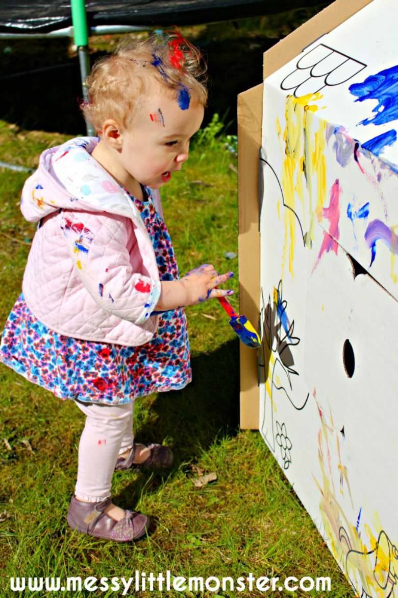 Cardboard Playhouse - Easy Outdoor Art Ideas for Kids - large scale, messy, nature inspired art activities for toddlers, preschoolers and school aged kids to do outside.