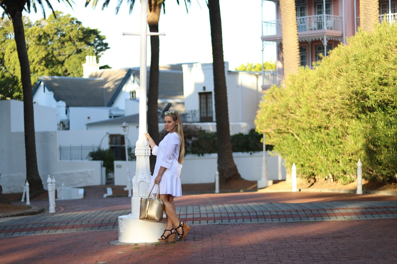 Katie Heath wearing white dress and wedges at the Belmond Mount Nelson Hotel