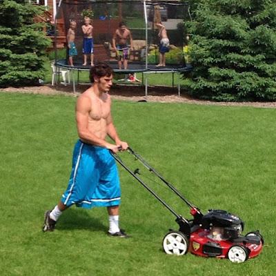 Hot-gardener-lawn-mowing