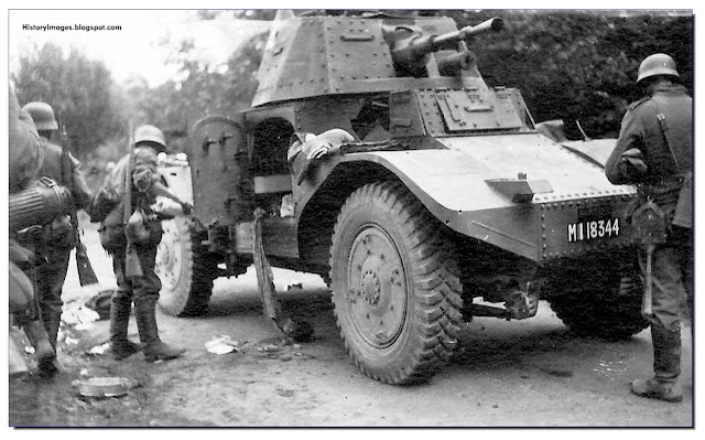 German soldiers examine a captured French armored car, Panhard 178. May-June 1940