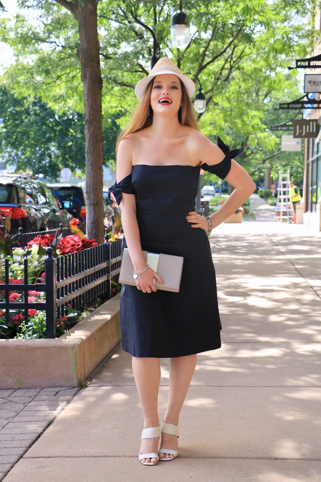 Fashion blogger Kathleen Harper of Kat's Fashion Fix showing how to wear a black dress