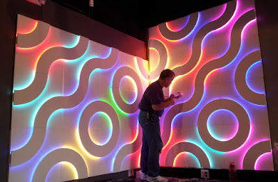 Textured 3d walls paneling idea with led lighting in different colors for wall art