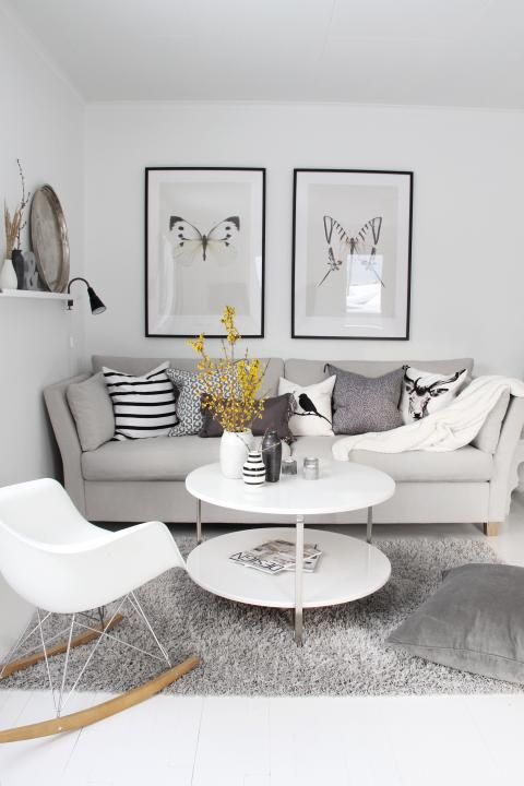 all white scandinavian living room with gray sofa and black accent