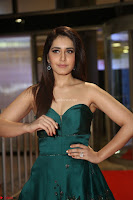 Raashi Khanna in Dark Green Sleeveless Strapless Deep neck Gown at 64th Jio Filmfare Awards South ~  Exclusive 093.JPG