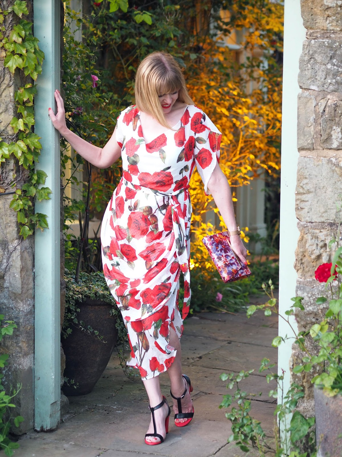 Alice's Pig White and red floral rose draped midi dress with red and black high-heeled sandals style over 40 floral clutch