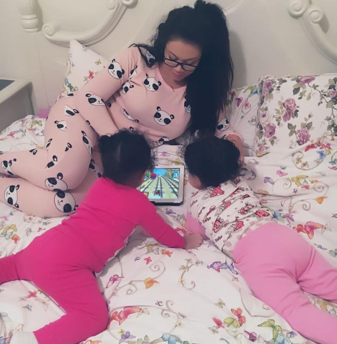 Nadia Buari plays with her two adorable twin daughters