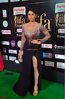 Hansika Motwani in Glittering Deep Neck Transparent Leg Split Purple Gown at IIFA Utsavam Awards 24.JPG