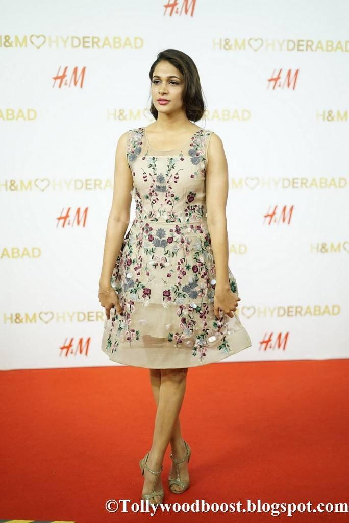 Lavanya Tripathi Long Legs Show In Mini Yellow Skirt At Store Launch