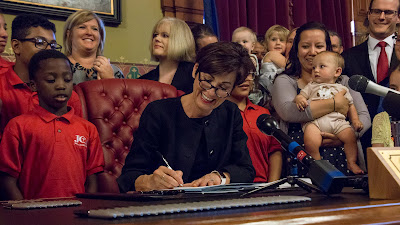 Iowa governor signs bill banning abortions on babies with beating hearts